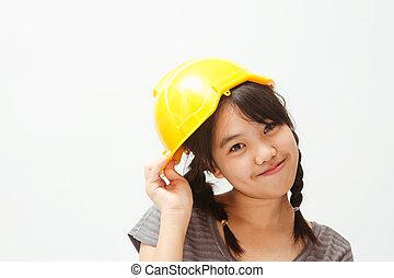 a cute asian girl wearing construction helmet