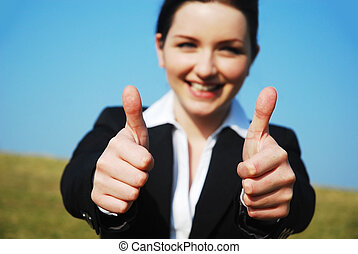 Thumbs Up! - Beautiful young businesswoman giving you a...