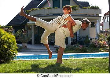 Senior couple workout - Happy senior couple doing workout...