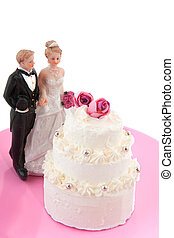 Wedding couple near the wedding cake with roses