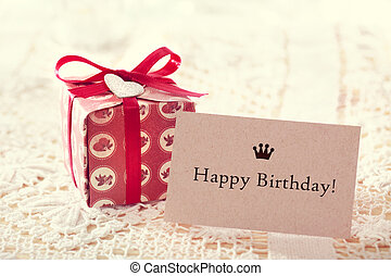 Happy birthday message with hand crafted present box