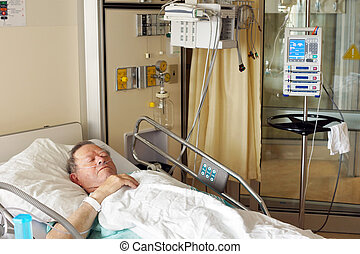 Senior man in hospital bed - Senior man lying in hospital...