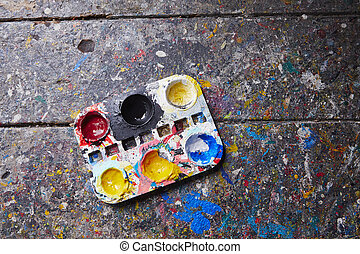 Palette on the old desk in workshop