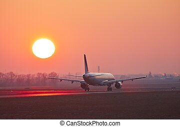 Airport at the sunset - Airplane is taking off at the...