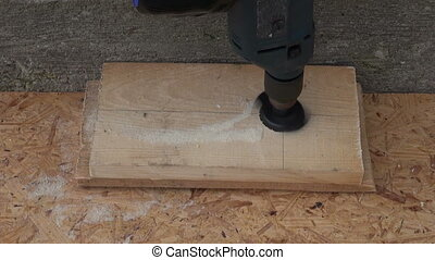 drilling hole for nesting-box - drilling hole with drill for...