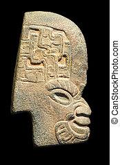 Inca idol profile isolated on black