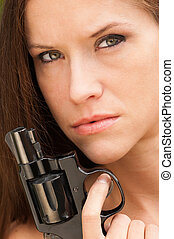 Pretty Woman Angry Looking Female Holds Pistol Revolver...