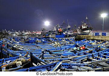 Blue fishing boats of Essaouira at night