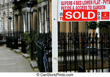 Sold Sign - A sold sign outside a British flat