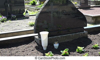 candle glass grave burn - candle in glass pot burn on grave...