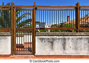 Gate - View through ornamental gate on sea
