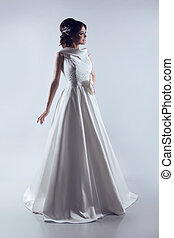 Beautiful Bride in elegant wedding dress. Fashion lady. Studio photo