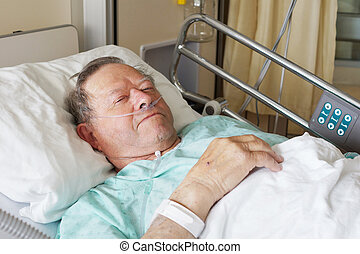 Man in hospital bed - Portrait of sick old man in hospital...