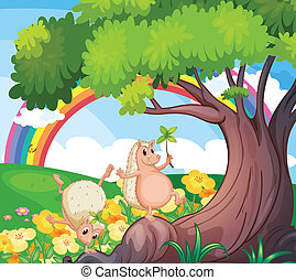 Two wild animals near the tree with flowers