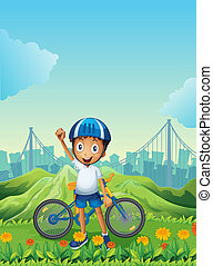 A boy and his bike standing across the tall mountains -...