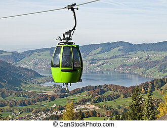 Cable car above autumn forest