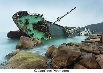 Wrecked ship along the rocky coast