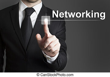 touchscreen networking - man in black suite pressing virutal...