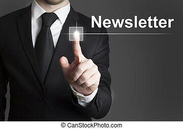 touchscreen newsletter - man in black suite pressing virutal...