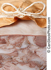 Headcheese wrapped in paper macro vertical