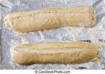 Bread dough batons rising