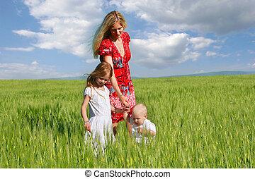 happy family in green field