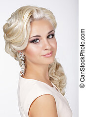 Elegance. Confident Groomed Blonde with Costume Jewelry
