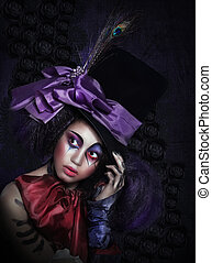 Expression. Pantomime. Clown in Fancy Carnival Hat with...