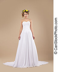 Espousal. Bride Fashion Model with Wreath of Flowers in White Dress