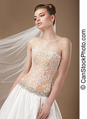 Elegance. Young Stylish Slender Woman in Golden Corset