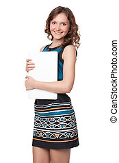 Portrait of a happy young woman posing with a laptop against...