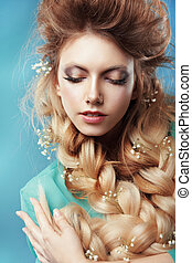 Enjoyment. Woman with Plait and Intertwined Flowers