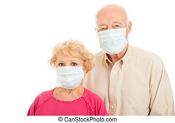 Epidemic - Senior Couple - Worried senior couple wearing...