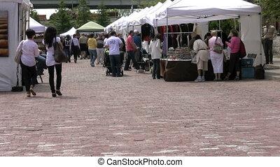 open market - footage of People enjoying  the open market