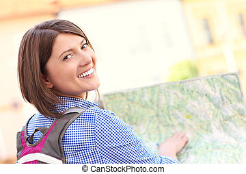 Young tourist with a map - A picture of a young tourist with...