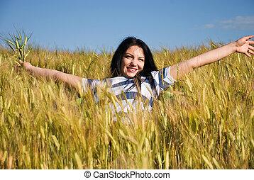 Beautiful woman in wheat field - Beautiful young woman...