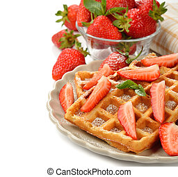 Belgian waffles with strawberries on a white background