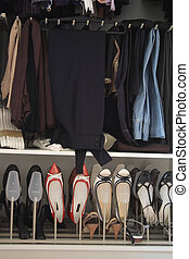 Womens Closet - Opened womens wardrobe with clothes and...
