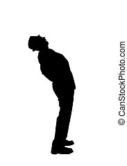 Silhouette of a Man Bending Over Ba - Silhouette of a man in...