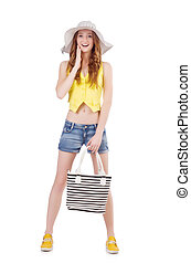 Young girl with panama and handbag in fashion concepts...