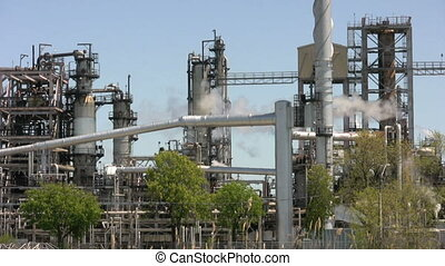 oil refinery - footage of oil refinery with plumes of smoke