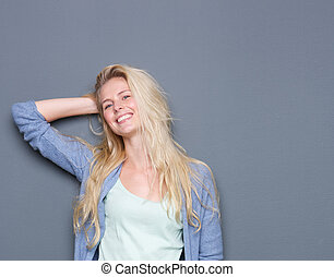 Portrait of a happy smiling young blond woman