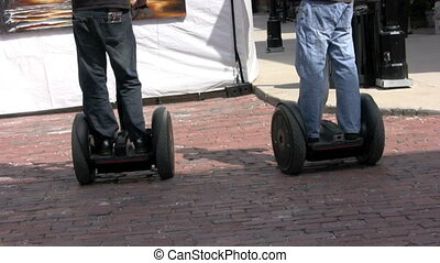 segway - footage of two men playing on personal transporters