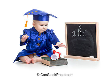 Baby in academician clothes  with book at  blackboard