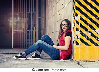Urban hipster girl - Sad teenage hipster girl sitting by the...