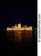 Beautiful view of parliament from Danube at night in...