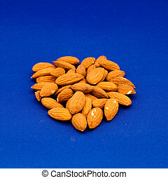 Pile of almonds - Almond is also the name of the edible and...