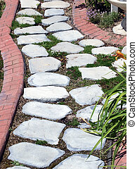 Garden path of stepping stones with brick pattern boarder -...