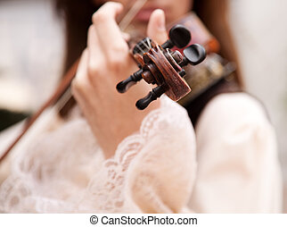 musician - man with vintage violin , selective focus on...