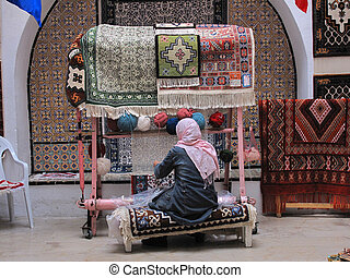 tunisia - Tunisia, Hammamet woman works carpets